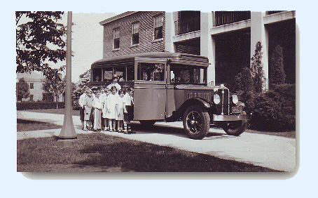 1931 Image of young students boarding school bus on a trip to the Bronx Zoo.