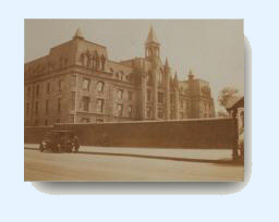 Early 20 century photo of the 9th Avenue school with model T automobile on street