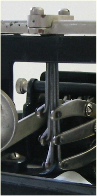 Closeup view of the braille producing  rods attached to the keys.